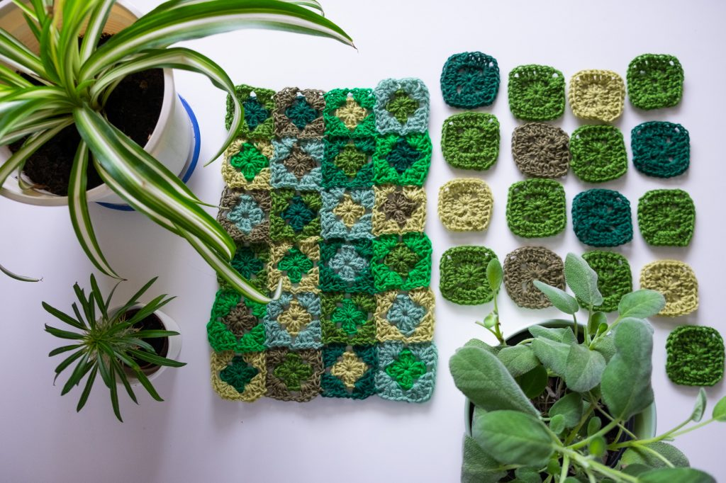Crochet pillow cover with green granny squares
